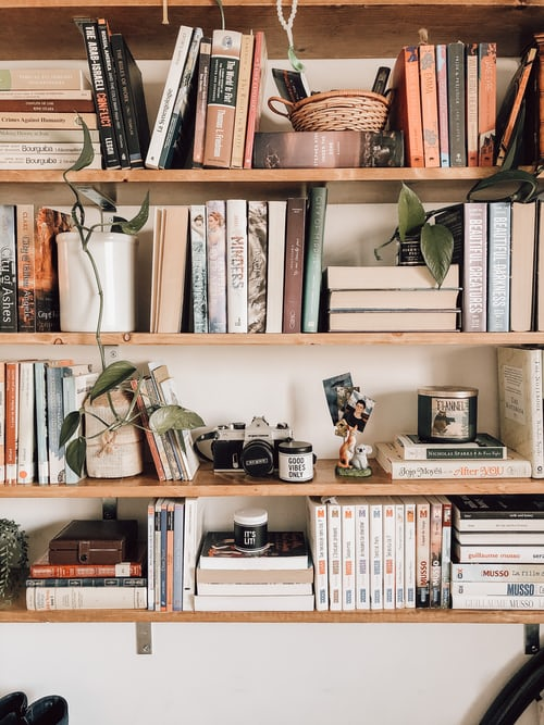 Photo of a bookshelf with many books on it